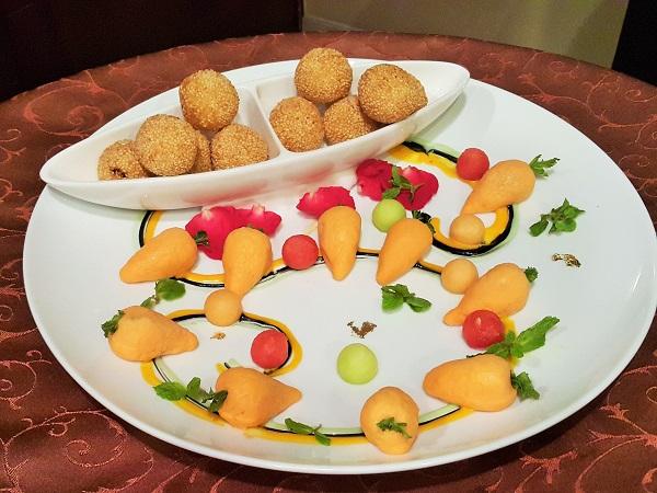 Deep-fried sesame balls with salted egg yol custard and sweet potato