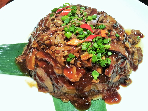 Stir-fried glutinous rice with Chinese-style preserved duck.
